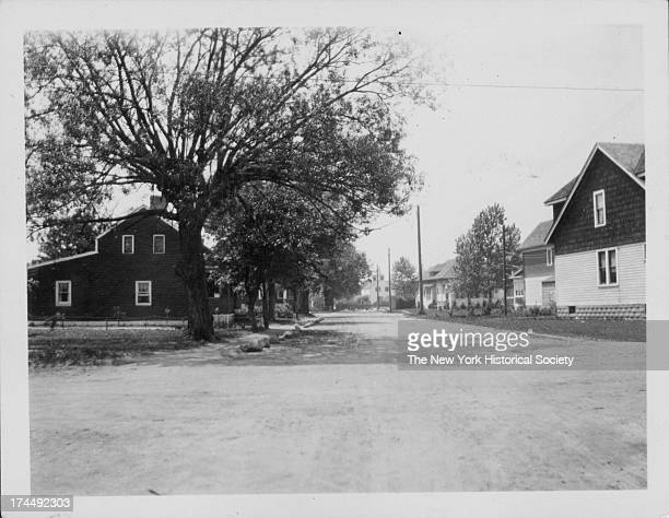 view of Mill Lane looking toward First Methodist Episcopal Church Red shingled house on left standing on corner plot of E 46th Street belonged to...