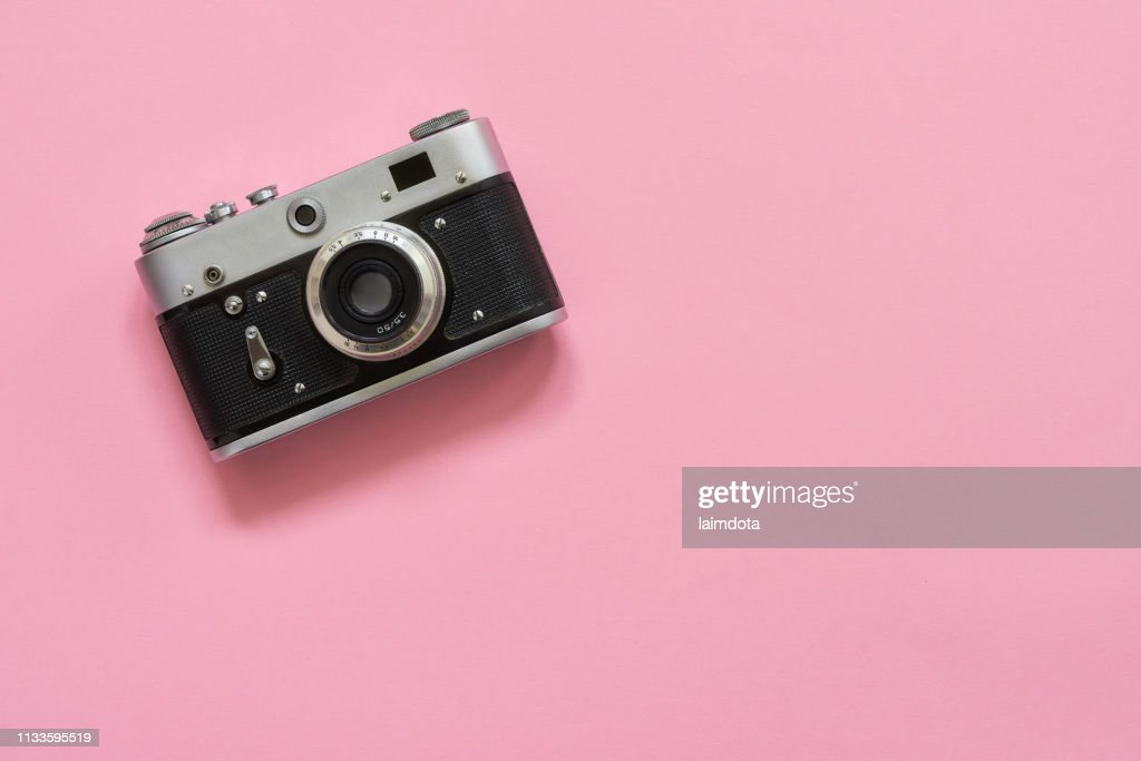 Flatlay vintage retro camera on pink background. Copy space, top view : Stock Photo
