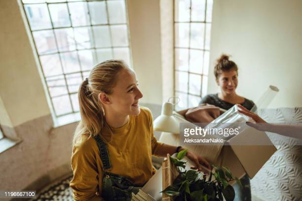 flatmates are moving into a students dorm - apartment stock pictures, royalty-free photos & images