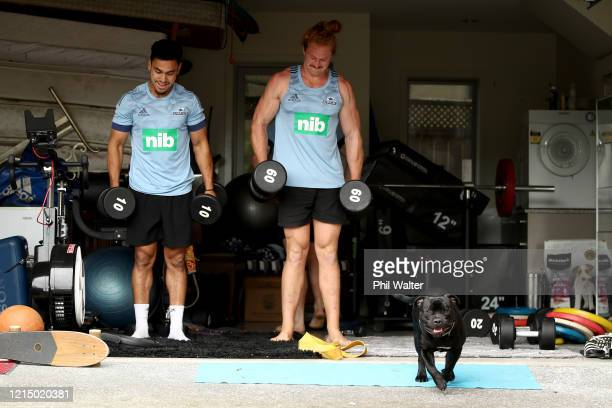Flatmates Stephen Perofeta and Tom Robinson of the Blues rugby team pictured during a weights session in their garage on March 27, 2020 in Auckland,...