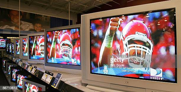 Flatpanel wide screen televisions display a football player a Best Buy store January 31 2006 in Niles Illinois Sales of televisions are reportedly up...
