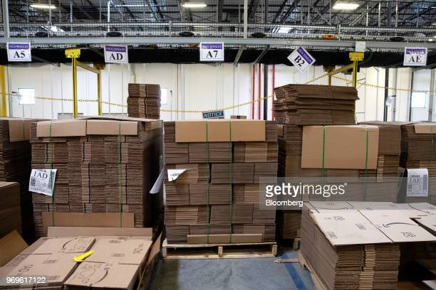 Flattened boxes sit stacked at the Amazoncom Inc fulfillment center in Robbinsville New Jersey US on Thursday June 7 2018 Seattlebased Amazon hasn't...