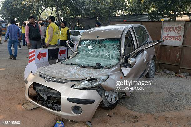 A flattened car is pictured after a section of an underconstruction flyover collapsed in New Delhi's northwestern area of Pitampura on February 12...