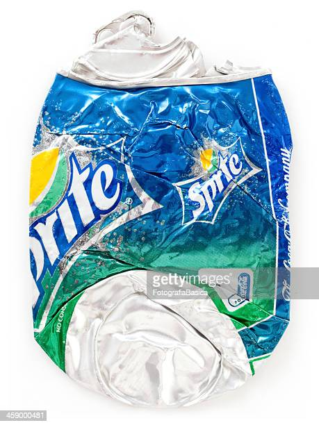 flattened sprite can - roadkill stock photos and pictures