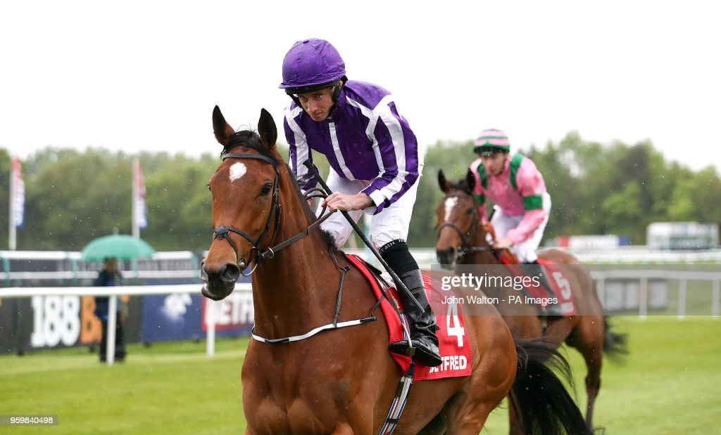 Flattering ridden by Jockey Ryan Moore in the Betfred Mobile Oaks Trial Fillies' Stakes during The Derby Trial day at Lingfield Racecourse, Lingfield
