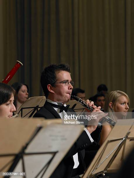 Flautist and oboe player performing in orchestra