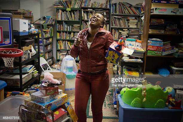 Flavia Ford discovers a rare Jack In The Box toy and is tickled by the object at the nonprofit A Wider Circle in Silver Spring Maryland on November...
