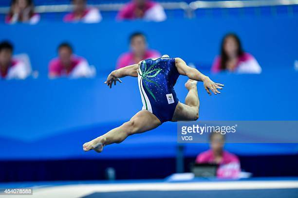 Flavia Lopes Saraiva of Brazil competes in the Women's Floor Exercise Final on day eight of the Nanjing 2014 Summer Youth Olympic Games at Nanjing...