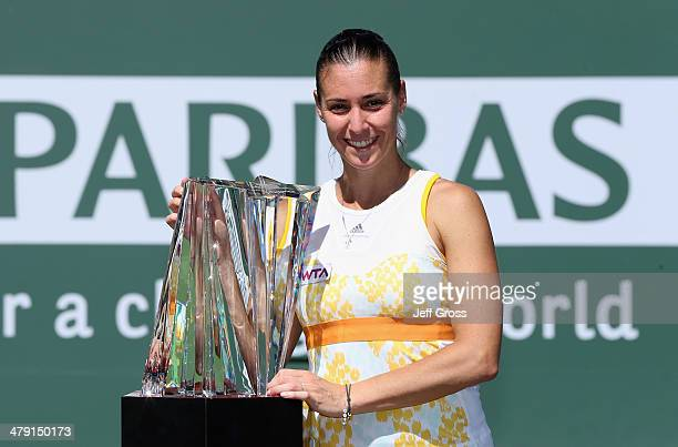 Flavia Penneta of Italy poses with the trophy following her WTA women's final victory over Agnieszka Radwanska of Poland during the BNP Paribas Open...