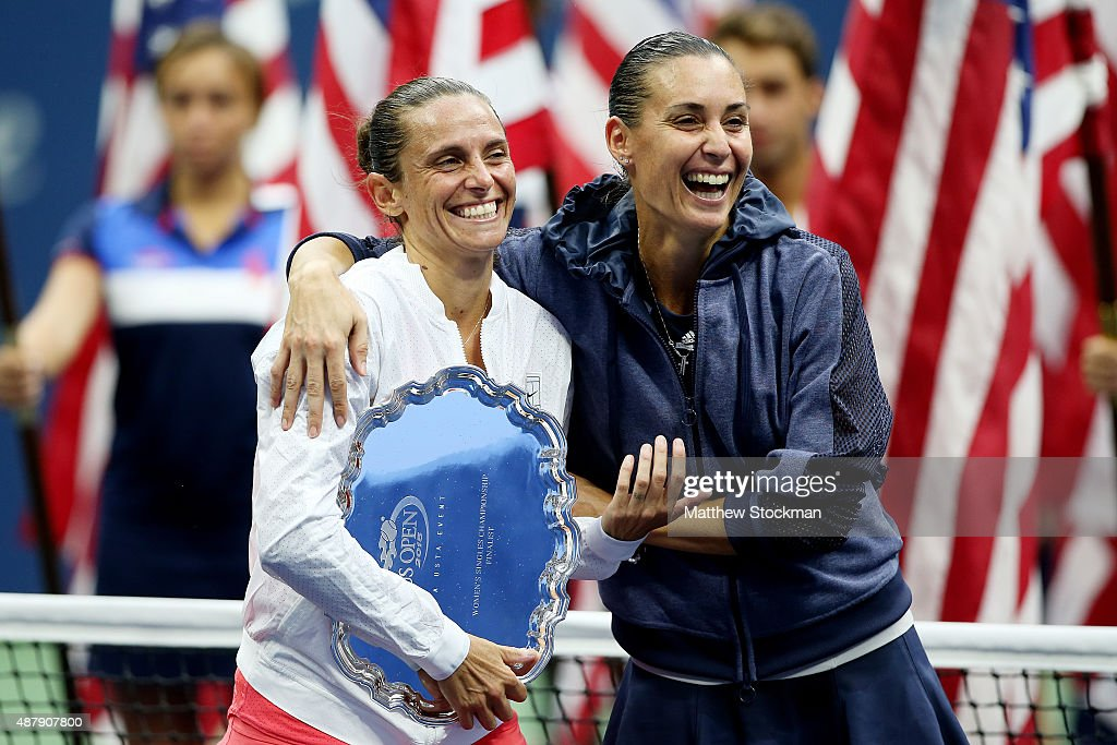 Flavia Pennetta (R) of Italy and Roberta Vinci (L) of Italy are interviewed by Broadcaster Robin Roberts (not pictured) after their Women's Singles Final match on Day Thirteen of the 2015 US Open at the USTA Billie Jean King National Tennis Center on September 12, 2015 in the Flushing neighborhood of the Queens borough of New York City. Pennetta defeated Vinci 7-6, 6-2.