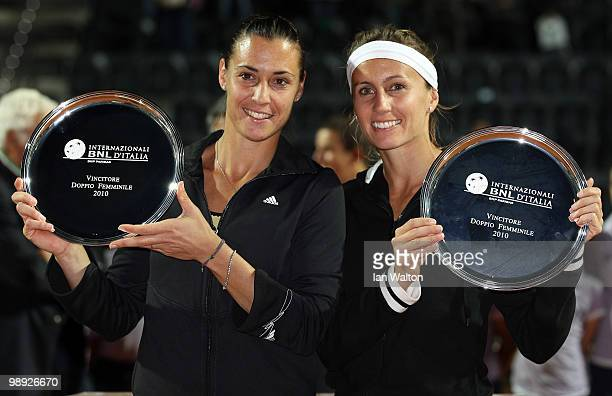 Flavia Pennetta of Italy and teammate Gisela Dulko of Argentina celebrate with their trophies after winning the doubles Final of the Sony Ericsson...