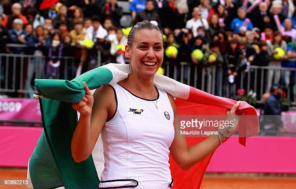 Flavia Pennetta of Italy celebrates a victory with her country flag after the Final of the Fed Cup World Group between Italy and the USA at Circolo...