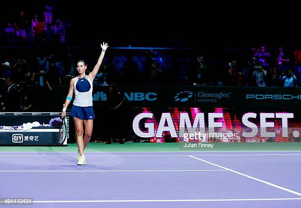 Flavia Pennetta of Italy celebrates after defeating Agnieszka Radwanska of Poland in a round robin match during the BNP Paribas WTA Finals at...