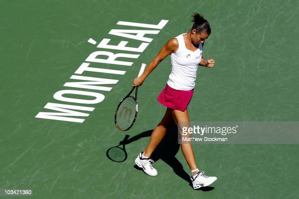 Flavia Pennetta of Italy celebrates breaking Daniela Hantuchova of Slovakia in the second set during the Rogers Cup at Stade Uniprix on August 17,...
