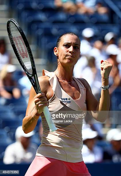 Flavia Pennetta of Italy celebrates match point to defeat Nicole Gibbs of the United States in women's singles third round match on Day Six of the...