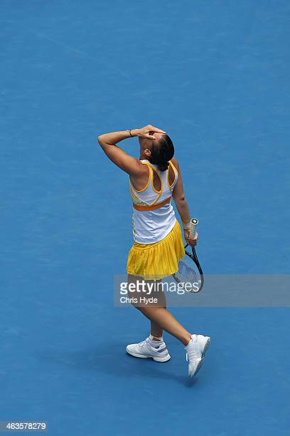 Flavia Pennetta of Italy celebrates winining her fourth round match against Angelique Kerber of Germany during day seven of the 2014 Australian Open...