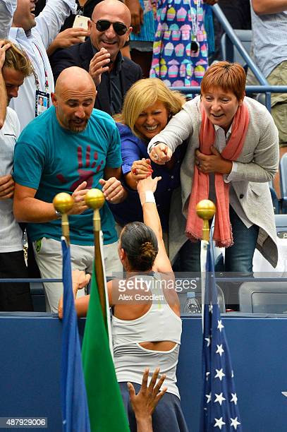 Flavia Pennetta of Italy celebrates with her Family after defeating Roberta Vinci of Italy during their Women's Singles Final match on Day Thirteen...