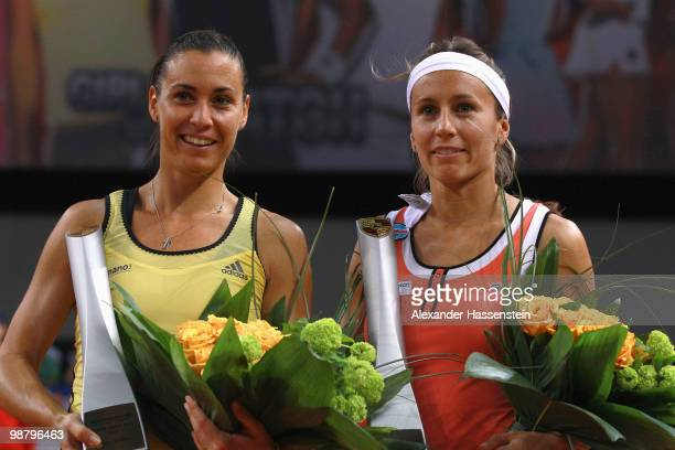 Flavia Pennetta of Italy celebrates with her team mate Gisela Dulko of Argentina winning the doubles final match against Kveta Peschke of Czech...
