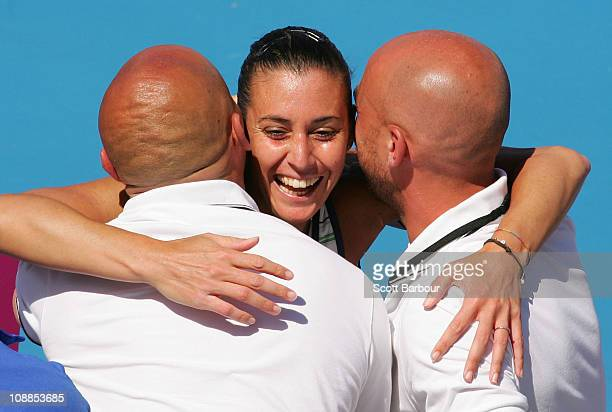 Flavia Pennetta of Italy celebrates with team officials after winning her match against Jarmila Groth of Australia during day two of the Federation...