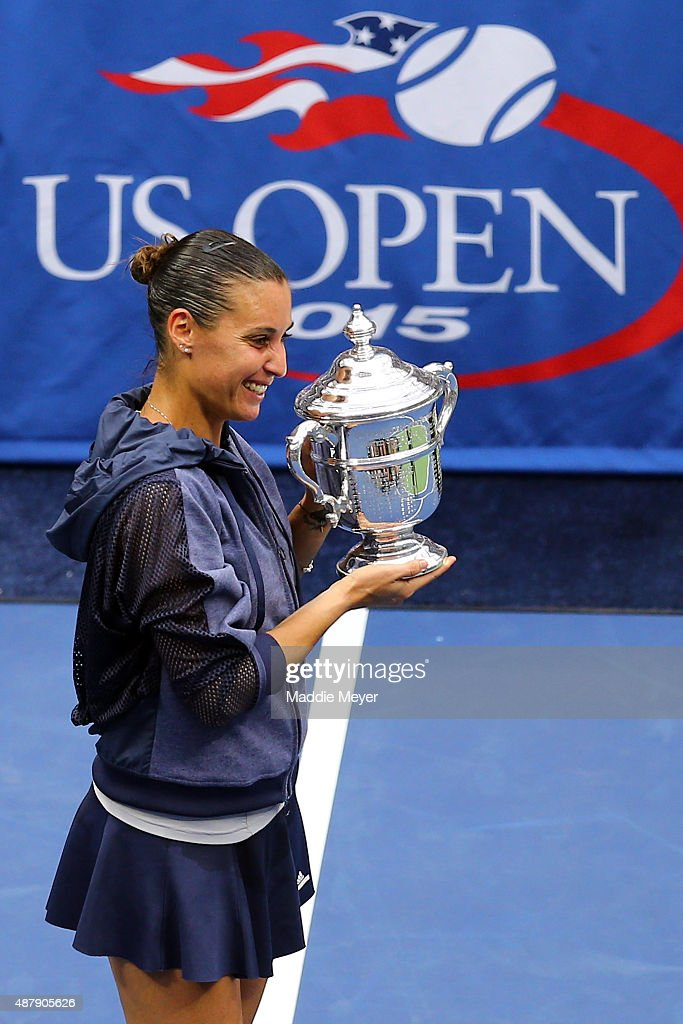 Flavia Pennetta of Italy celebrates with the winner's trophy after defeating Roberta Vinci of Italy during their Women's Singles Final match on Day Thirteen of the 2015 US Open at the USTA Billie Jean King National Tennis Center on September 12, 2015 in the Flushing neighborhood of the Queens borough of New York City. Pennetta defeated Vinci 7-6, 6-2.