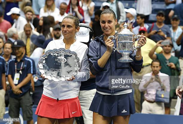 Flavia Pennetta of Italy celebrates with the winner's trophy after defeating Roberta Vinci of Italy during the Women's Singles Final trophy ceremony...