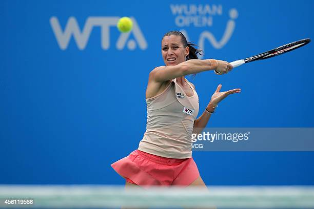 Flavia Pennetta of Italy compete against Raquel KopsJones of USA and Abigail Spears of USA during day six of the 2014 Dongfeng Motor Wuhan Open at...