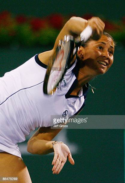 Flavia Pennetta of Italy hits a serve to Ana Ivanovic during the BNP Paribas Open at the Indian Wells Tennis Garden on March 17 2009 in Indian Wells...
