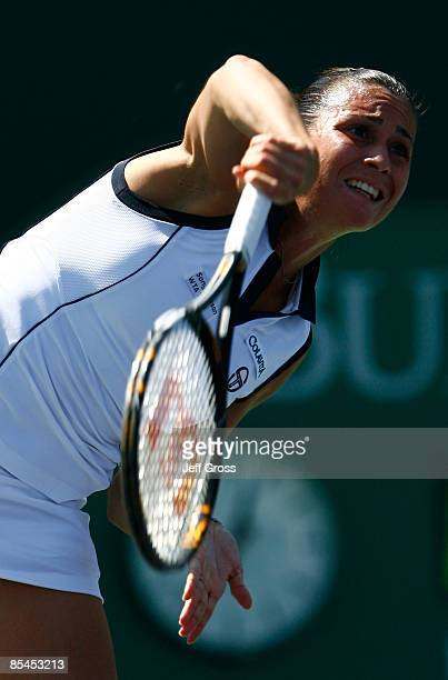 Flavia Pennetta of Italy hits a serve to Angela Haynes during the BNP Paribas Open at the Indian Wells Tennis Garden on March 16, 2009 in Indian...