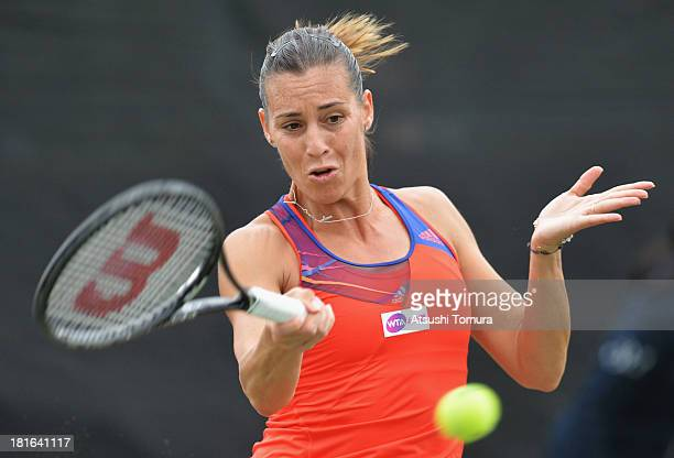 Flavia Pennetta of Italy in action during her women's singles first round match against Daniela Hantuchova of Slovakia during day two of the Toray...