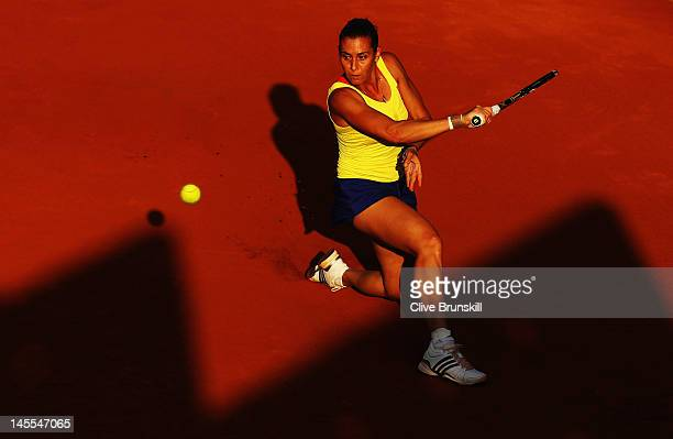 Flavia Pennetta of Italy plays a backhand during her women's singles third round match against Angelique Kerber of Germany during day 6 of the French...