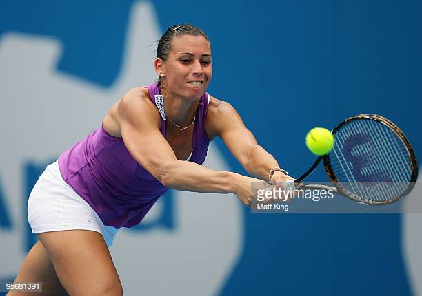 Flavia Pennetta of Italy plays a backhand in her first round match against Samantha Stosur of Australia during day two of the 2010 Medibank...