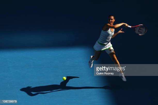 Flavia Pennetta of Italy plays a forehand in her third round match against Shahar Peer of Israel during day six of the 2011 Australian Open at...