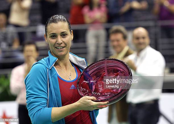 Flavia Pennetta of Italy poses for a photo with her championship trophy during the Singapore Womens Tennis Exhibtion at Singapore Indoor Stadium on...