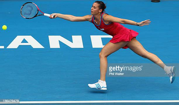 Flavia Pennetta of Italy reaches for a forehand in her match against Elena Vesnina of Russia during day four of the 2012 ASB Classic at the ASB...