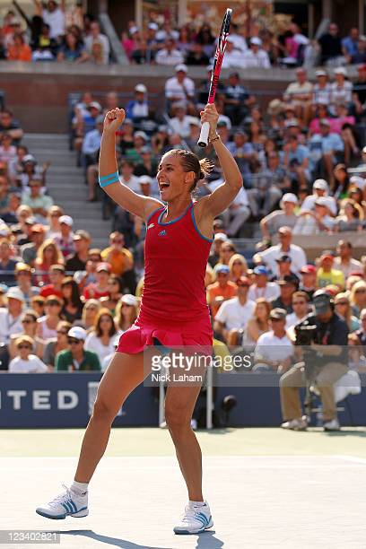 Flavia Pennetta of Italy reacts after a point against Maria Sharapova of Russia during Day Five of the 2011 US Open at the USTA Billie Jean King...