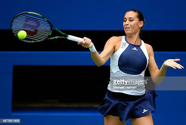 Flavia Pennetta of Italy returns a forehand shot to Roberta Vinci of Italy during their Women's Singles Final match on Day Thirteen of the 2015 US...