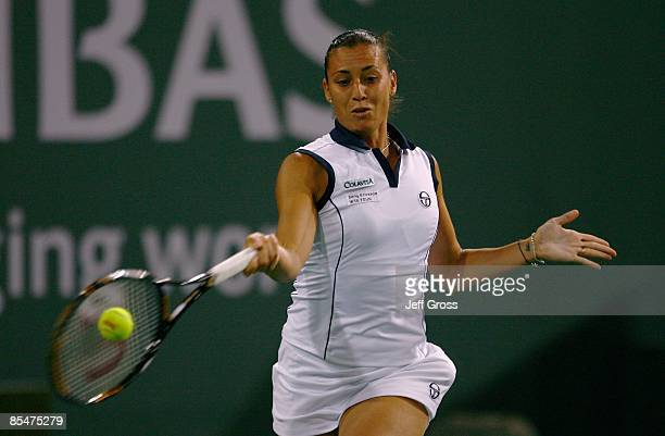 Flavia Pennetta of Italy returns a forehand to Ana Ivanovic during the BNP Paribas Open at the Indian Wells Tennis Garden on March 17 2009 in Indian...