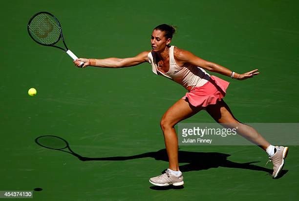 Flavia Pennetta of Italy returns a shot against Nicole Gibbs of the United States during her women's singles third round match on Day Six of the 2014...
