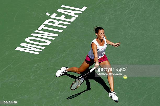 Flavia Pennetta of Italy returns a shot to Daniela Hantuchova of Slovakia during the Rogers Cup at Stade Uniprix on August 17 2010 in Montreal Canada