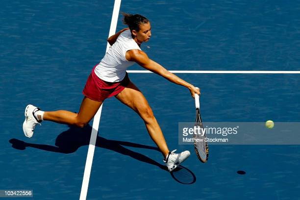 Flavia Pennetta of Italy returns a shot to Daniela Hantuchova of Slovakia during the Rogers Cup at Stade Uniprix on August 17, 2010 in Montreal,...