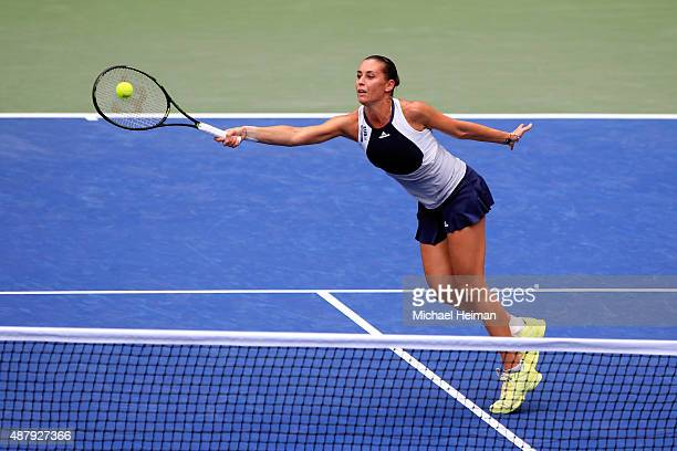 Flavia Pennetta of Italy returns a shot to Roberta Vinci of Italy during their Women's Singles Final match on Day Thirteen of the 2015 US Open at the...