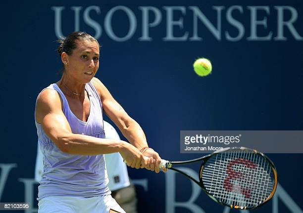 Flavia Pennetta of Italy returns to Bethanie Mattek during Women's Singles Semifinals of the East West Bank Classic Day 6 at Home Depot Center on...
