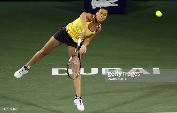 Flavia Pennetta of Italy serves during her first round match against Melinda Czink of Hungary during day two of the WTA Dubai Tennis Championships on...