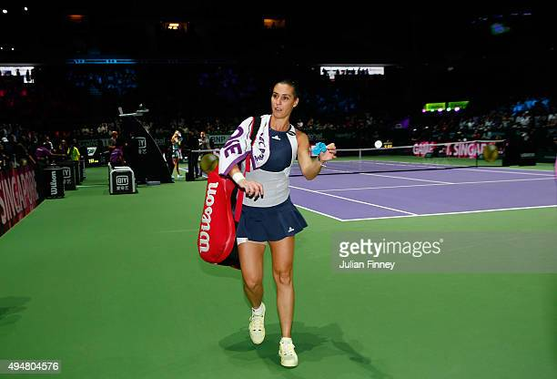 Flavia Pennetta of Italy walks off court after being defeated by Maria Sharapova of Russia in a staight set victory during the BNP Paribas WTA Finals...