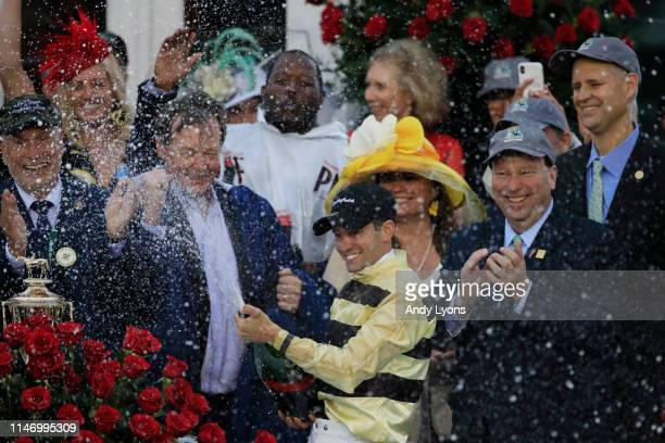 Flavien Prat jockey of Country House celebrates after winning the 145th running of the Kentucky Derby at Churchill Downs on May 04 2019 in Louisville...
