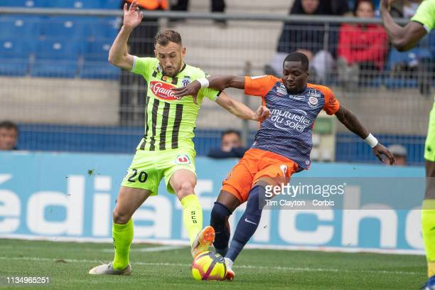 Flavien Tait of Angers challenged by Ambroise Oyongo Bitolo of Montpellier during the Montpellier V Angers French Ligue 1 regular season match at...