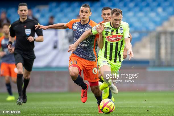 Flavien Tait of Angers challenged by Ellyes Skhiri of Montpellier during the Montpellier V Angers French Ligue 1 regular season match at Stade de la...