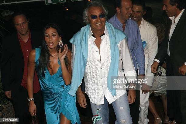 Flavio Briatore and Elisabetta Gregoraci attend the Fawaz Gruosi Birthday Party at the Billionhaire on August 8 2006 in Porto Cervo Sardinia