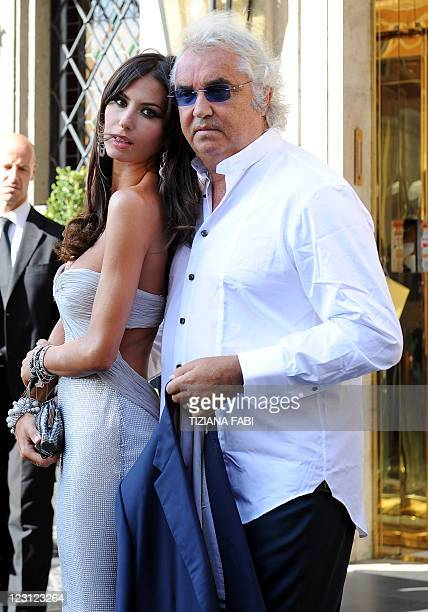 Flavio Briatore and his wife Elisabetta Gregoraci pose as they leave a hotel in central Rome to attend the wedding ceremony of F1 chief Bernie...