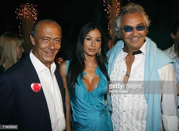 Flavio Briatore with Elisabetta Gregoraci and Fawaz Gruosi attend the Fawaz Gruosi Birthday Party at the Billionhaire on August 8 2006 in Porto Cervo...